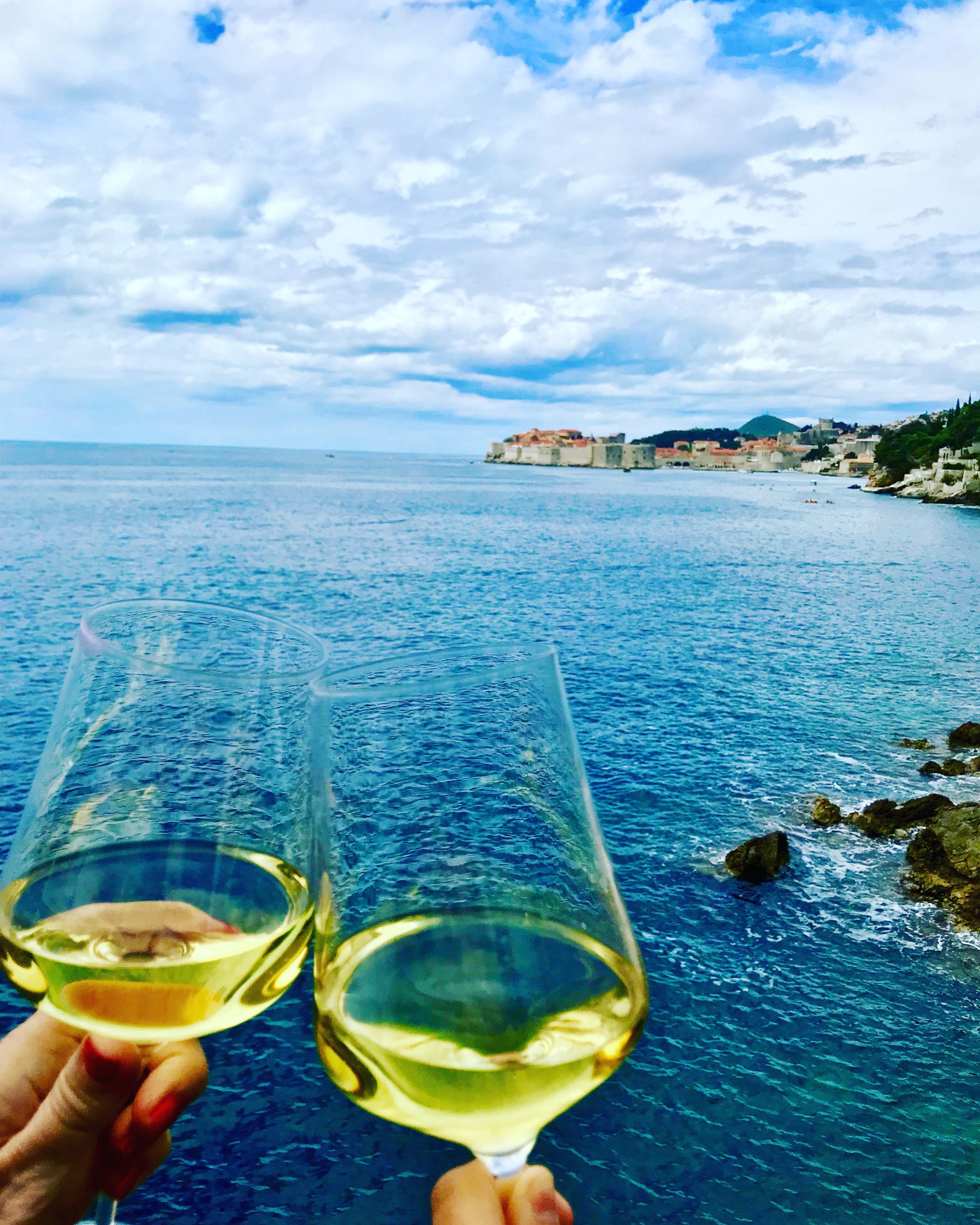 Tracy Dunn and Morgan Dunn enjoying their view from Villa Dubrovnik, and glass of wine, and a delicious lunch on the outside terrace.