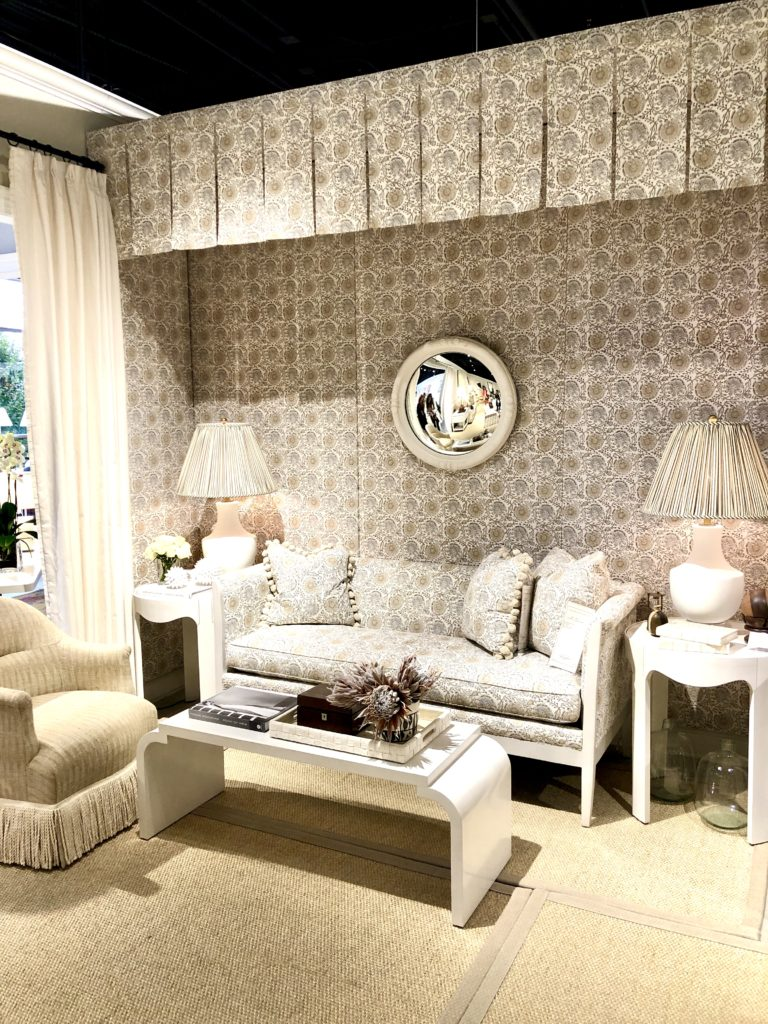 A neutral display of fabrics, furniture, and lighting at High Point Market. Custom lampshades make all the difference.